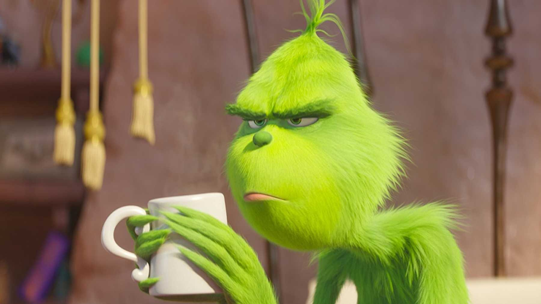 The Grinch (2018) holding coffee mug